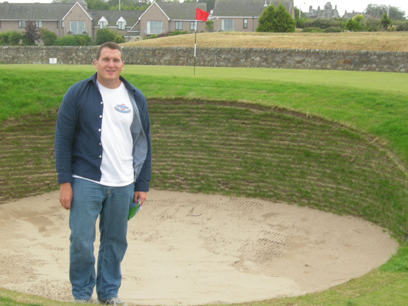 Standing in a bunker at the 17th hole at St. Andrews old course